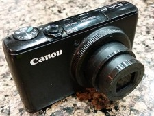 My broken Canon S95, with the lens which is stuck open...  RIP old friend